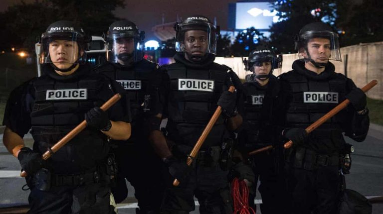 A group of police officers in riot gear