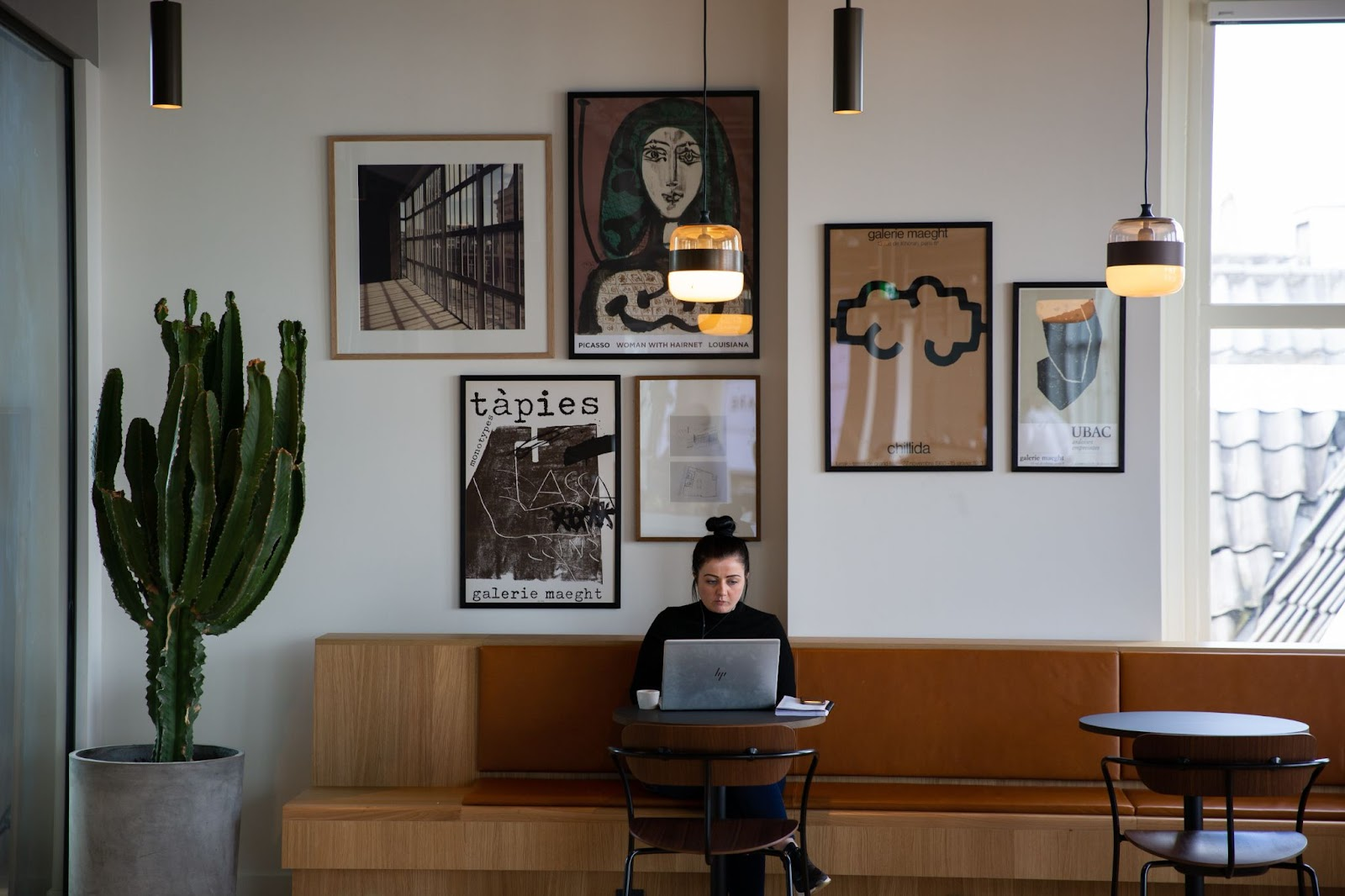 woman on her laptop in a coffeeshop