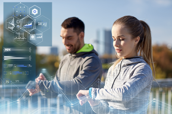 Wearable technology trends: Two runners with smartwatches