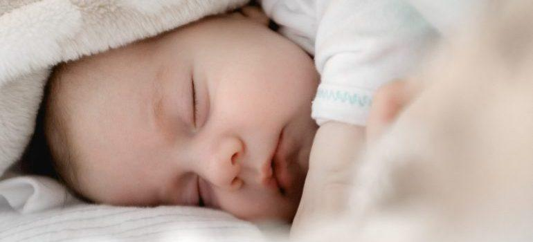 Cute baby sleeping in their new home