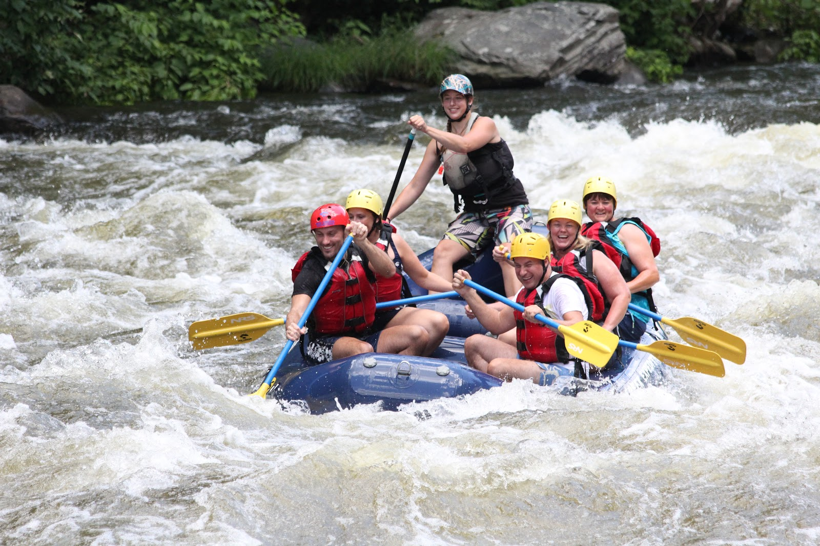 Guided rafting trip going through some white water