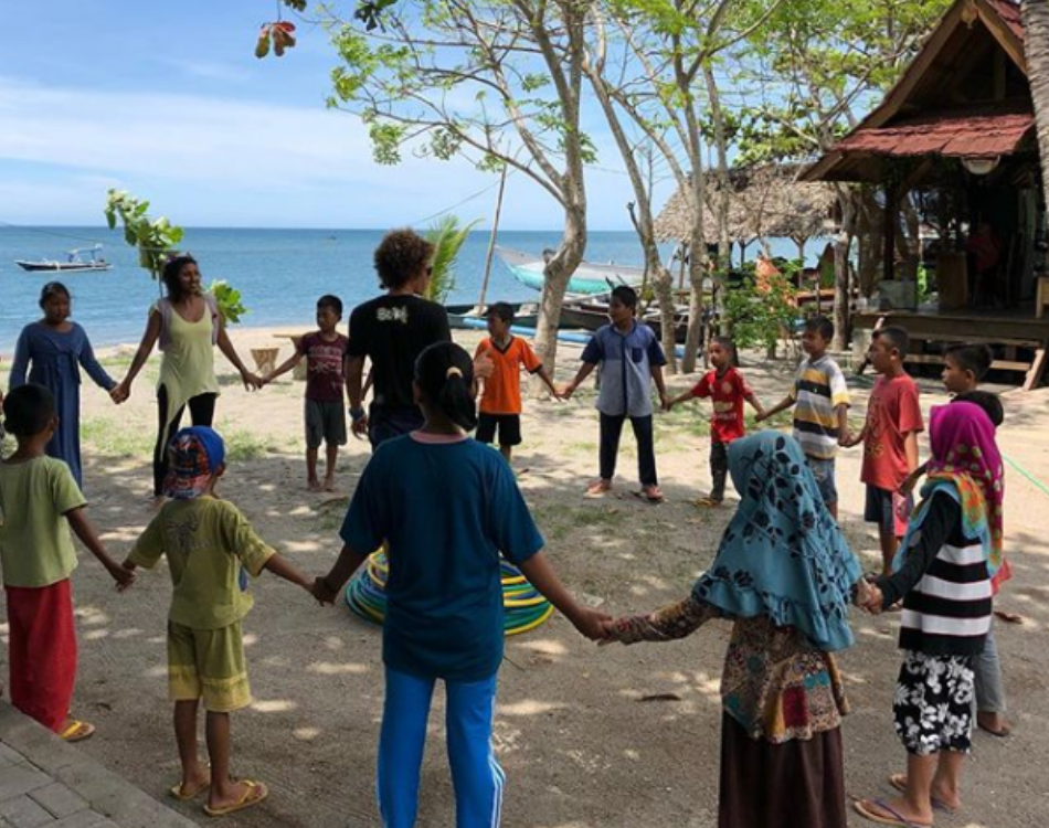 The Fiery Pixies coaching children in Lombok