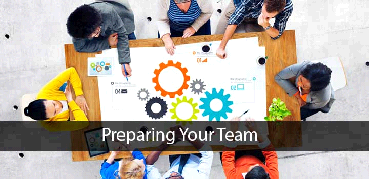 Top view of people working around a table - Preparing Your Team