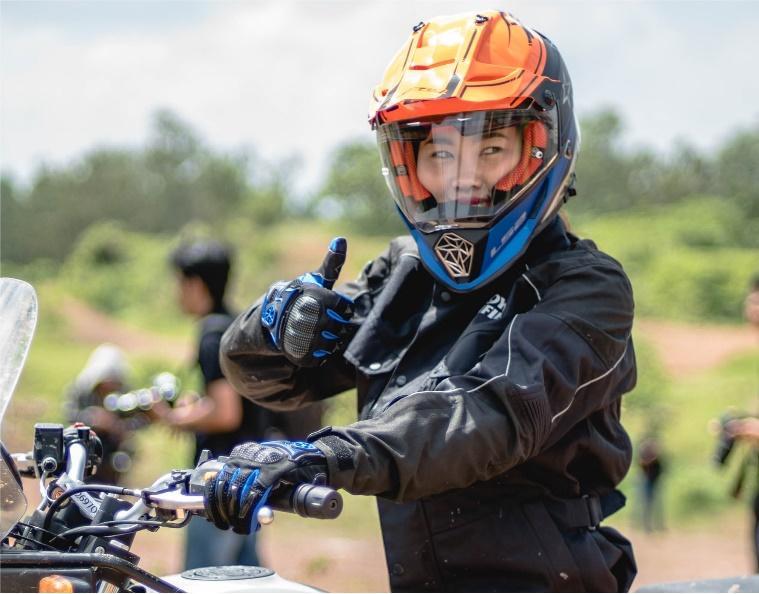 Wearing her complete gear as she ride in Vietnam