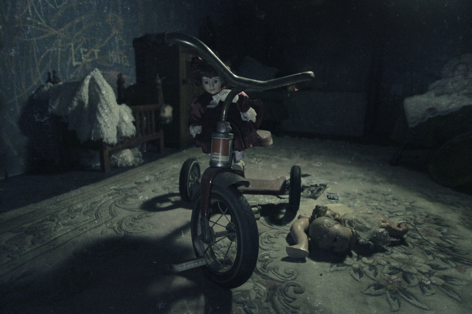 Inside the Daycare escape room with a tricycle