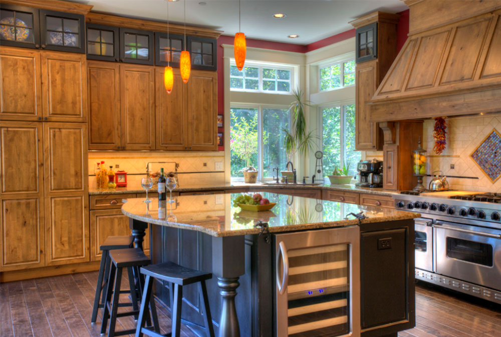 rustic kitchen with large custom island, hickory cabinets, and small corner sink