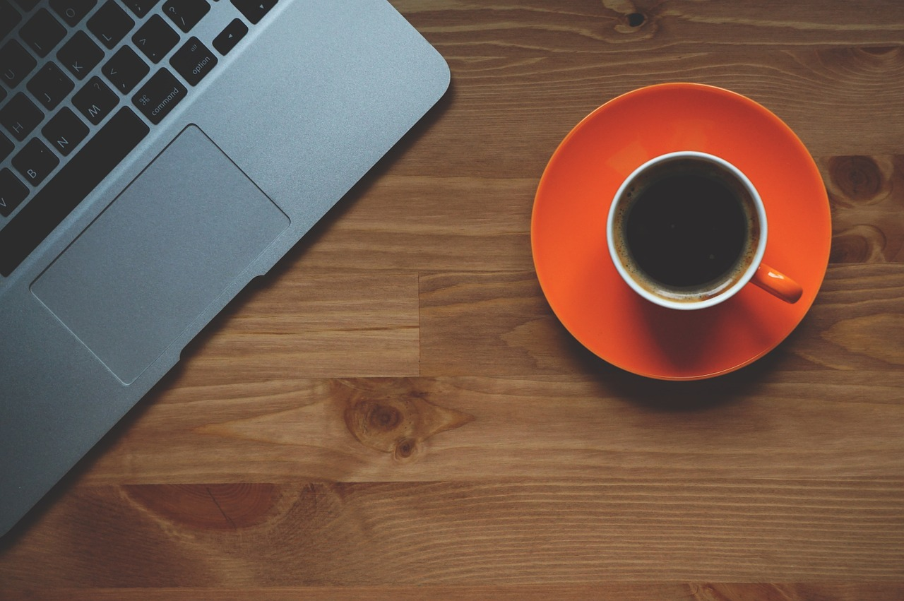 a laptop and a cup of coffee