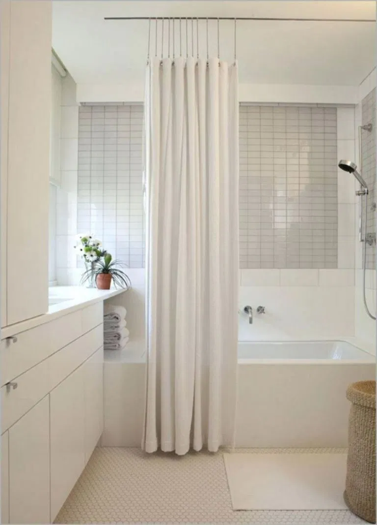 white modern bathroom with white flat panel cabinets, glossy subway tile backsplash and white modern shower curtain