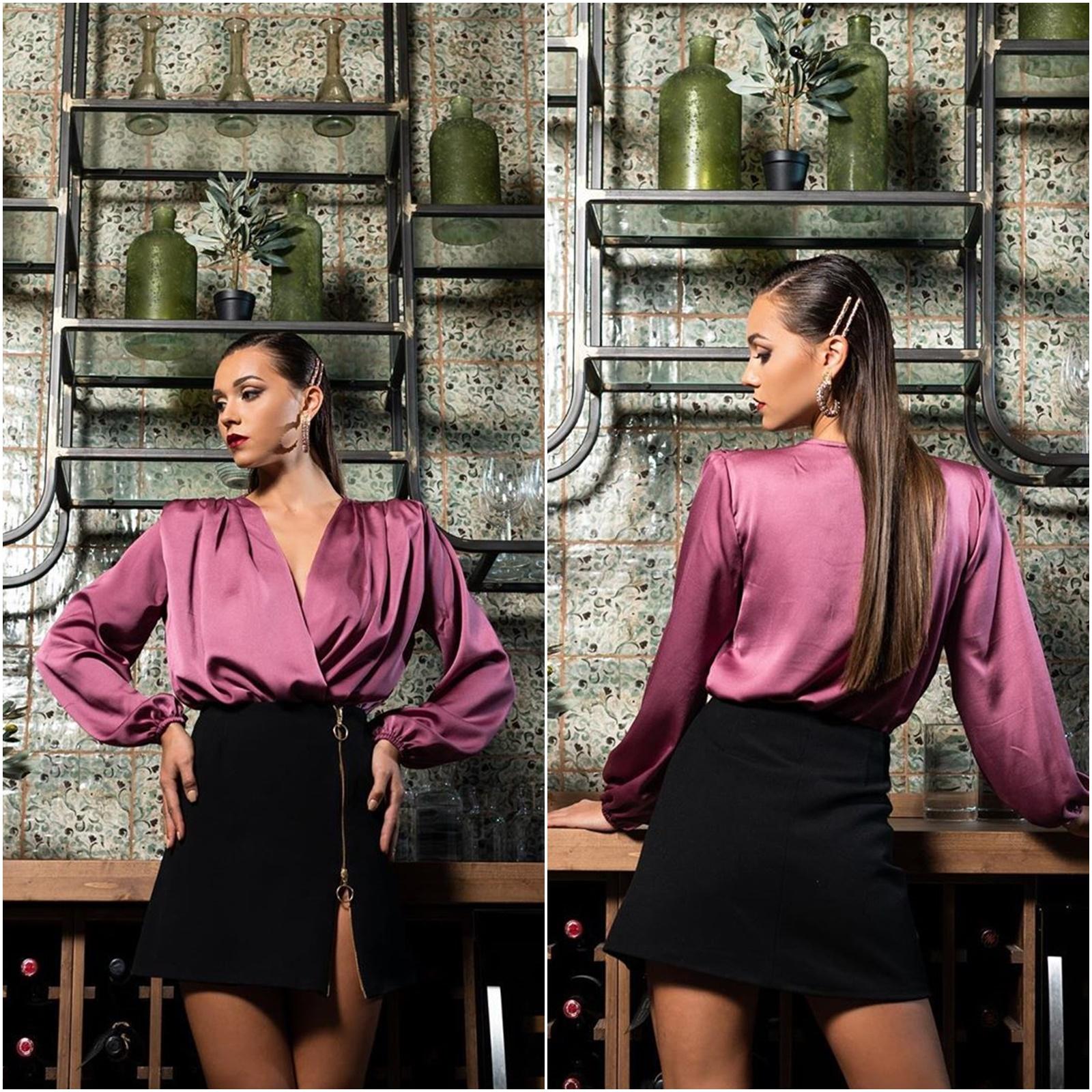 Романтично боди тип блуза с широки ръкави и дълбоко деколте в актуалния за сезона цвят касис.
