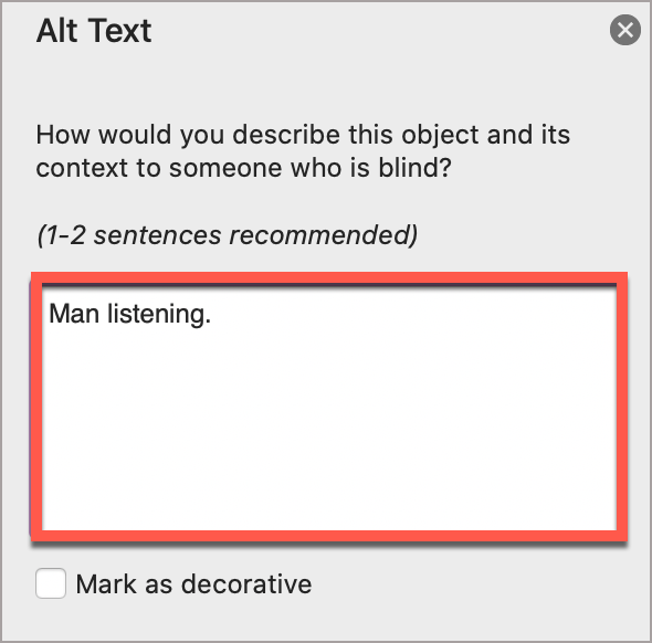 """In the PowerPoint Alt Text window, write the alt text in the box.  In this case, the alt text is, """"Man listening."""""""