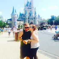 Aaron and Emily in front of the Disney World castle