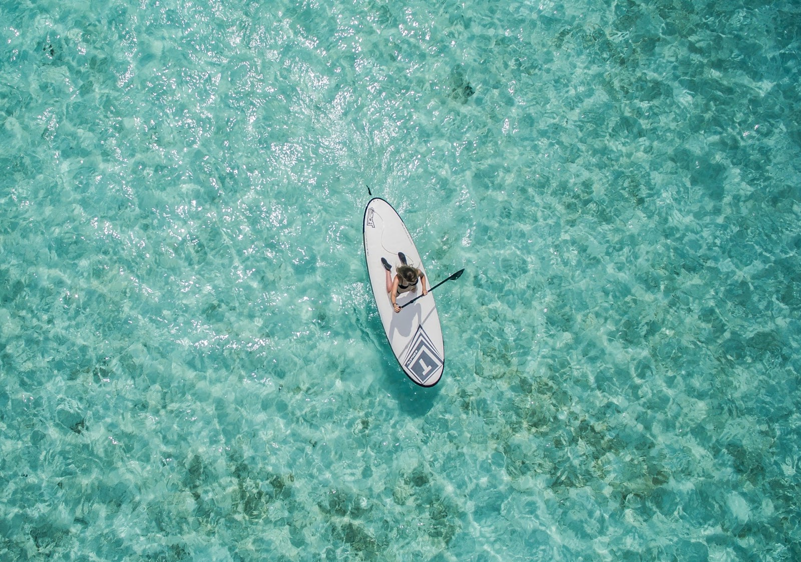 activities for people of all ages, girl on a paddleboard cruising through the waves