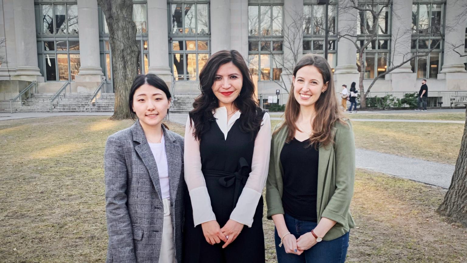 Rayhan smiles with Jasmine Shin (left) and Samantha Lint (right) in Harvard Yard.
