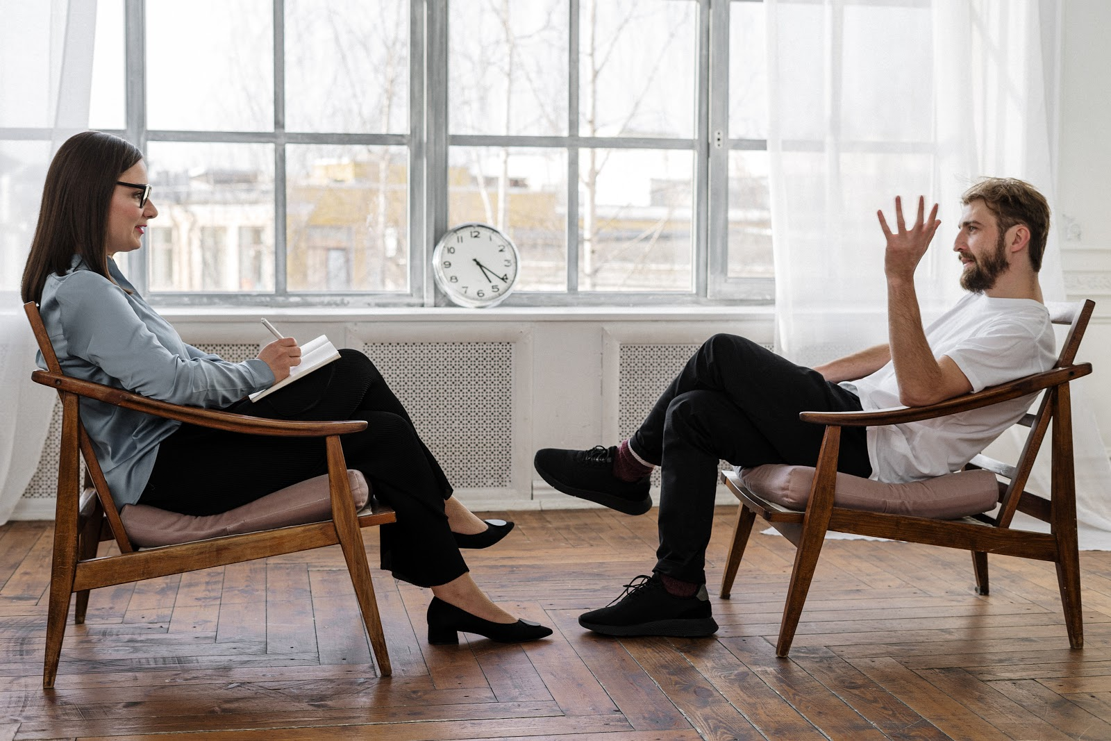 A man meets and discuss with the professional counsellor to cope with anxiety