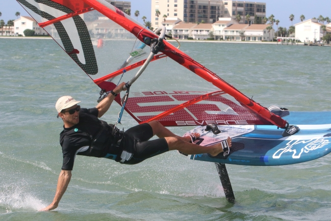 A man rides a sail board at the Clearwater Community Sailing Center.