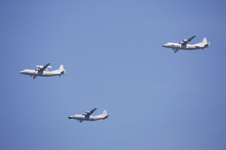 A KJ-200 AEW&C aircraft, left; a Y-8J, centre; and a Y-9JB, right. (AP/PA)