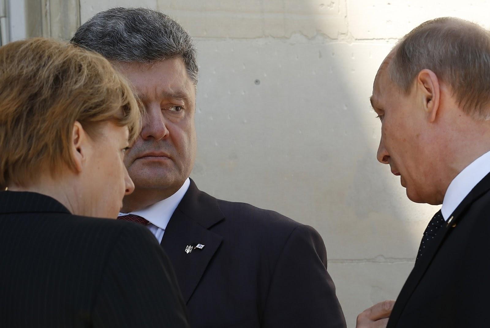 Putin, Poroshenko and Merkel talk in Normandy