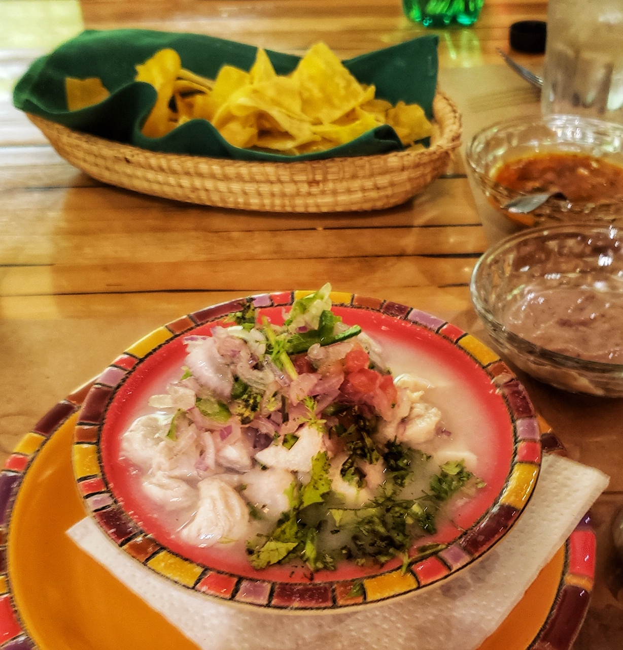 Ecuadorian fish and shrimp ceviche served with the cooking juices and an a bowl of plantain chips.