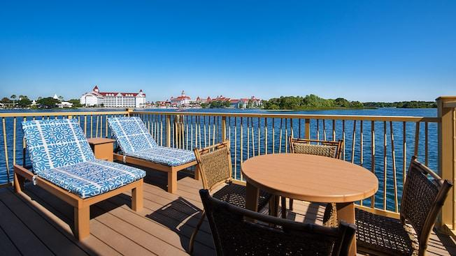 An outdoor deck area featuring lounge furniture that overlooks Disney's Grand Floridian Hotel & Spa