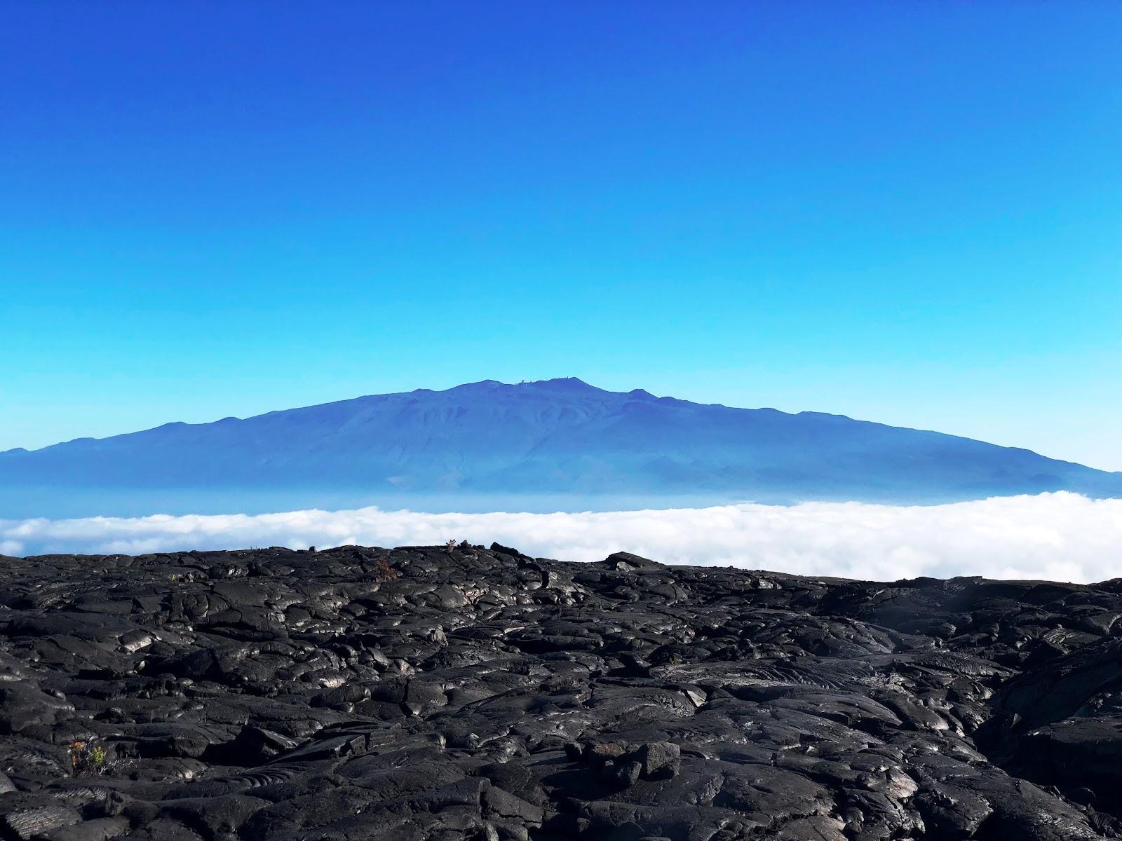 View across lava on Mauna Loa of Mauna Kea to the north.