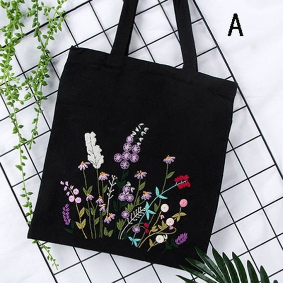DIY crafts embroidery bags with flowers on the front of a black canvas bag