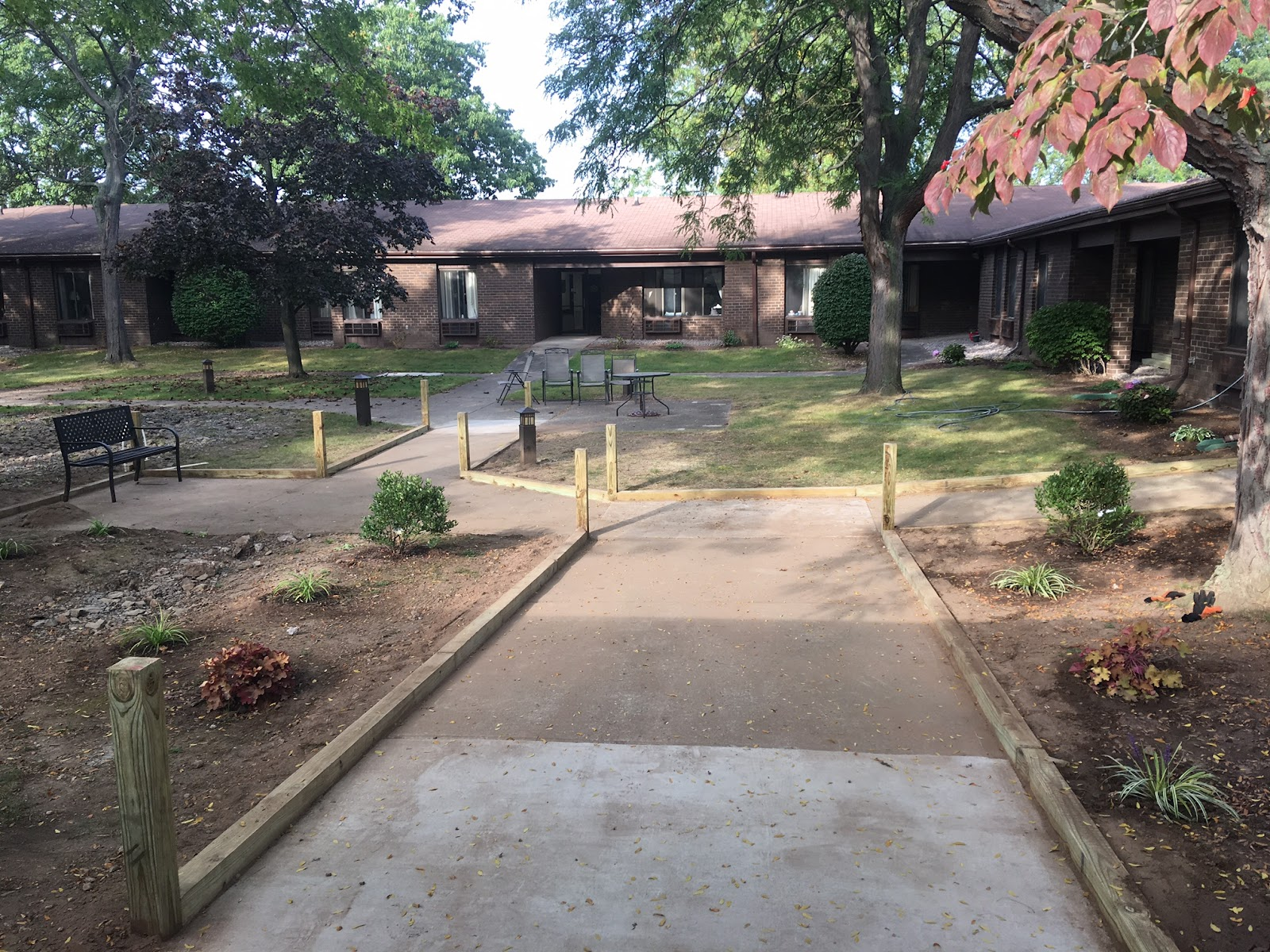 The Maintenance Department Has Been Hard At Work Laying Down Stone,  Planting And Putting Up Wood Railing Accents Along The Walkways.