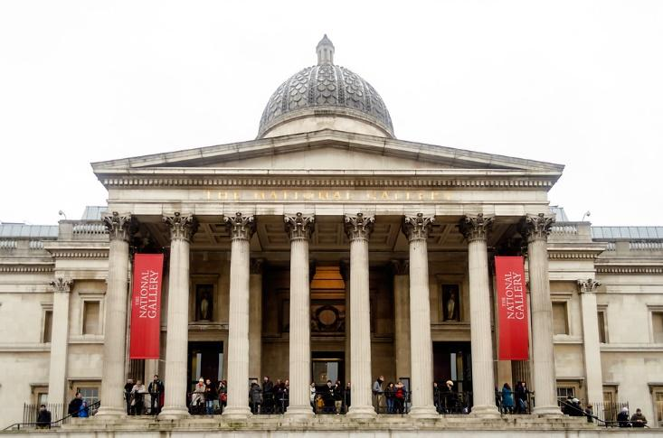 The neo-classical style front façade of the National Gallery, a free museum in London