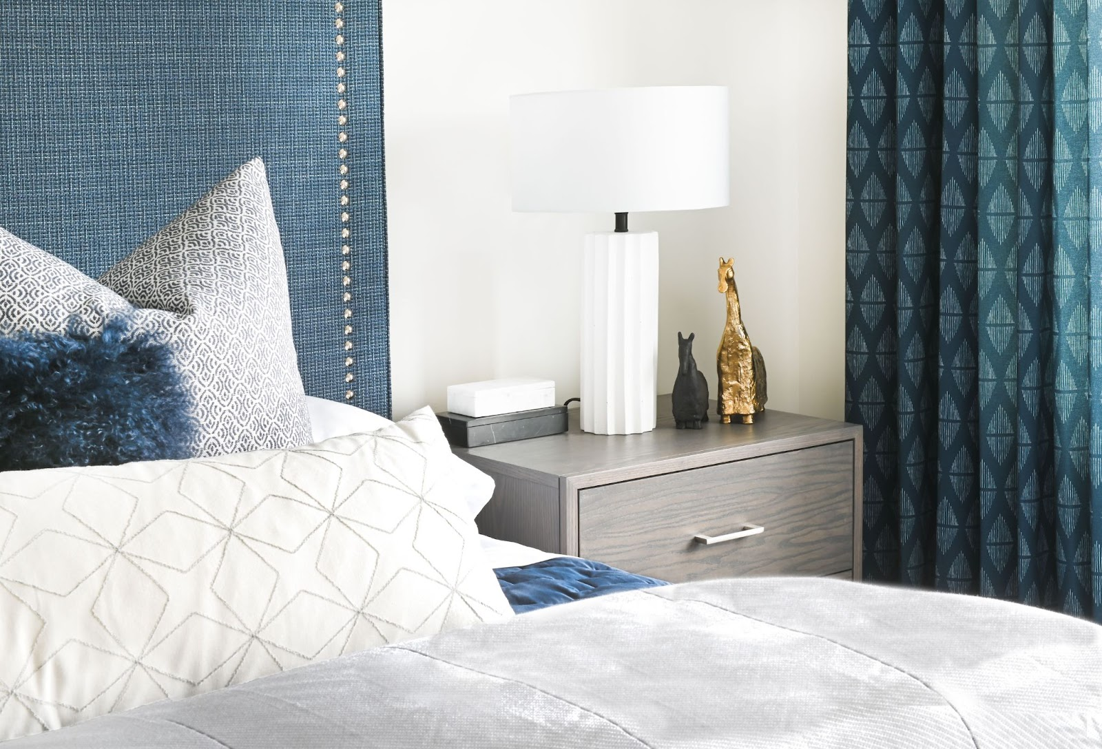maria-decotiis-west-vancouver-ca-invest-in-interior-designer-designer-bedroom-with-blues-headboard-matching-drapes