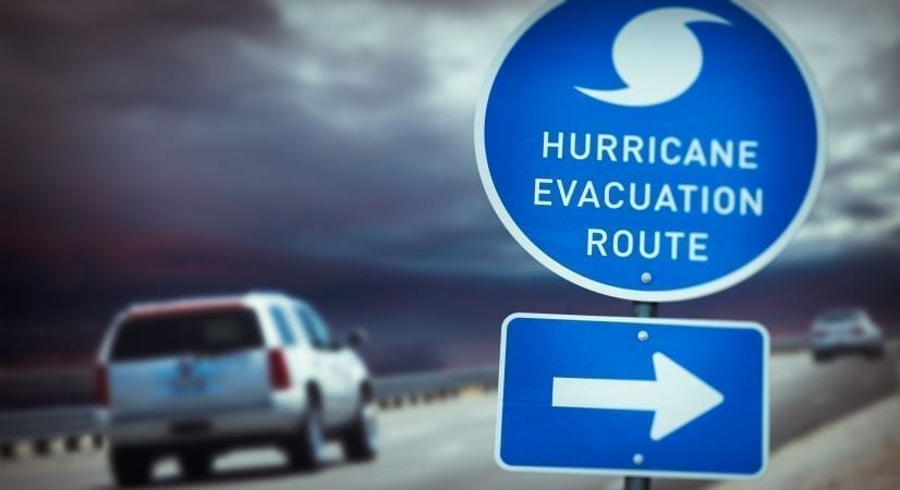 Storm clouds over road with hurricane evacuation route sign