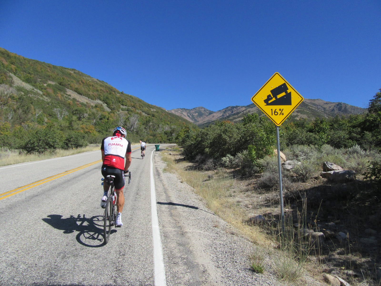 PJAMM bicyclist passing steep grade sign on Powder Mountain bike climb