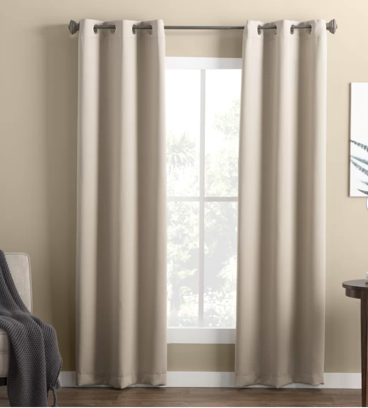window with white curtains on either side