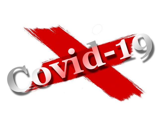 """Painted red """"X"""" with """"Covid-19"""" in white text on top over the X."""
