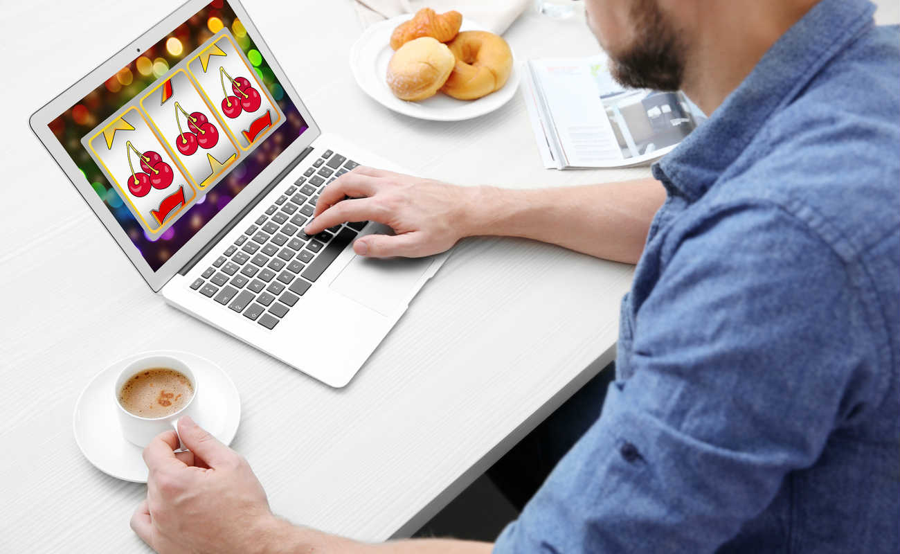 Man using laptop for playing online casino game at home