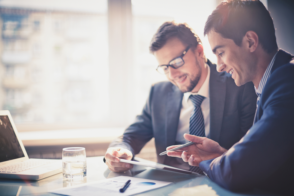 satisfied-businessmen-working-through-their-business-loans