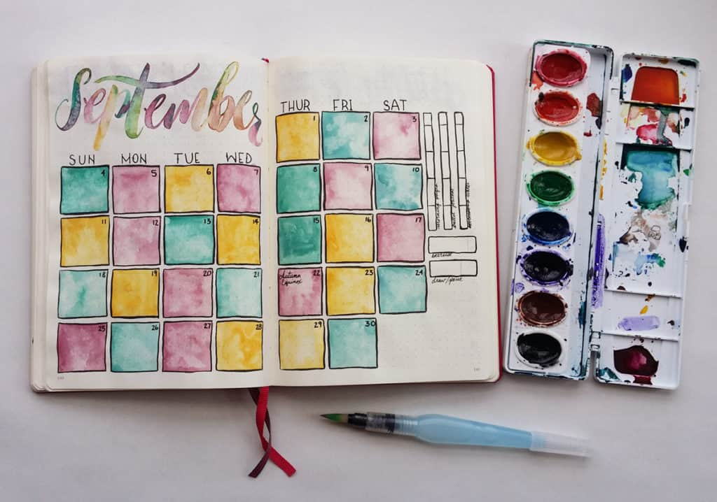 A September Bullet Journal theme using watercolor in the calendar boxes