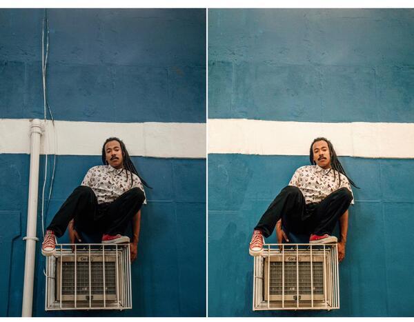 Foto de um homem negro em cima de uma grade com ar condicionado sendo editada pelo AirBrush