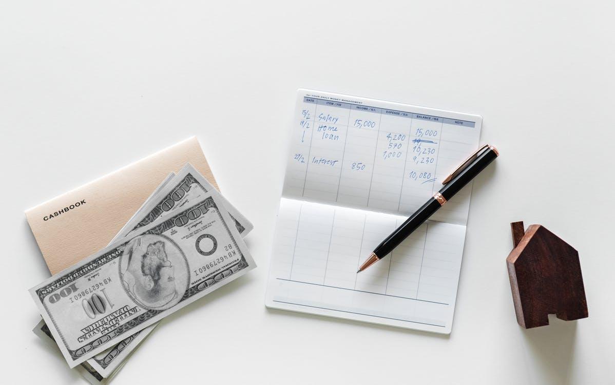 Ballpoint Pen on Top of White Printer Paper Beside 100 U.s. Dollar Bill