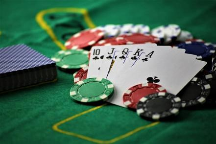 A picture containing room, scene, gambling house  Description automatically generated