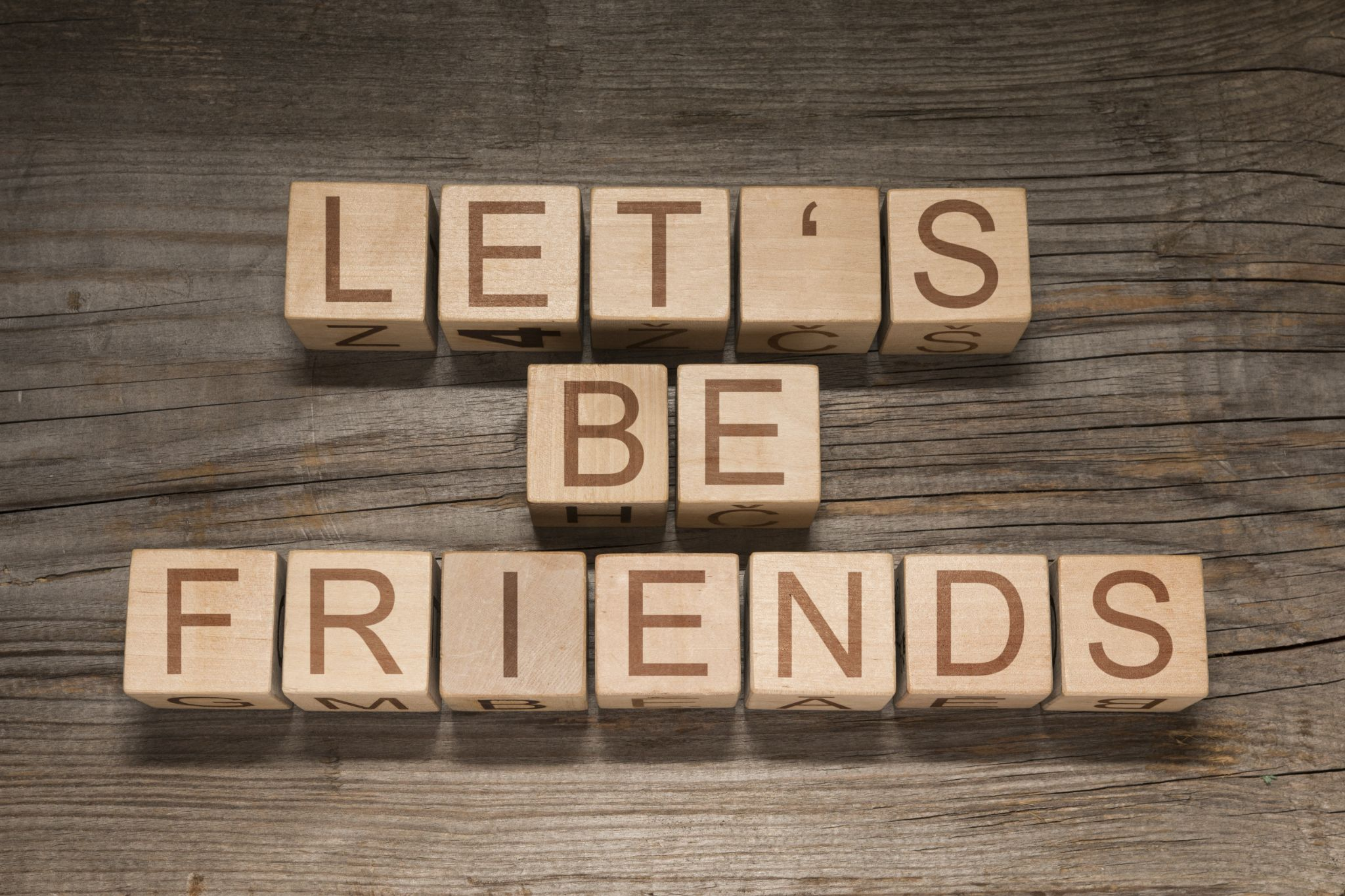 Wooden blocks saying let's be friends