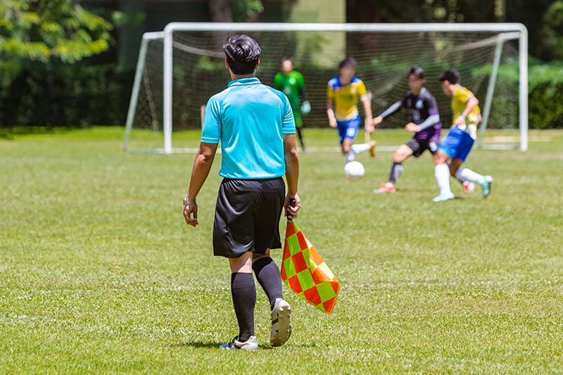 Soccer match behind assistant referee - how to play soccer