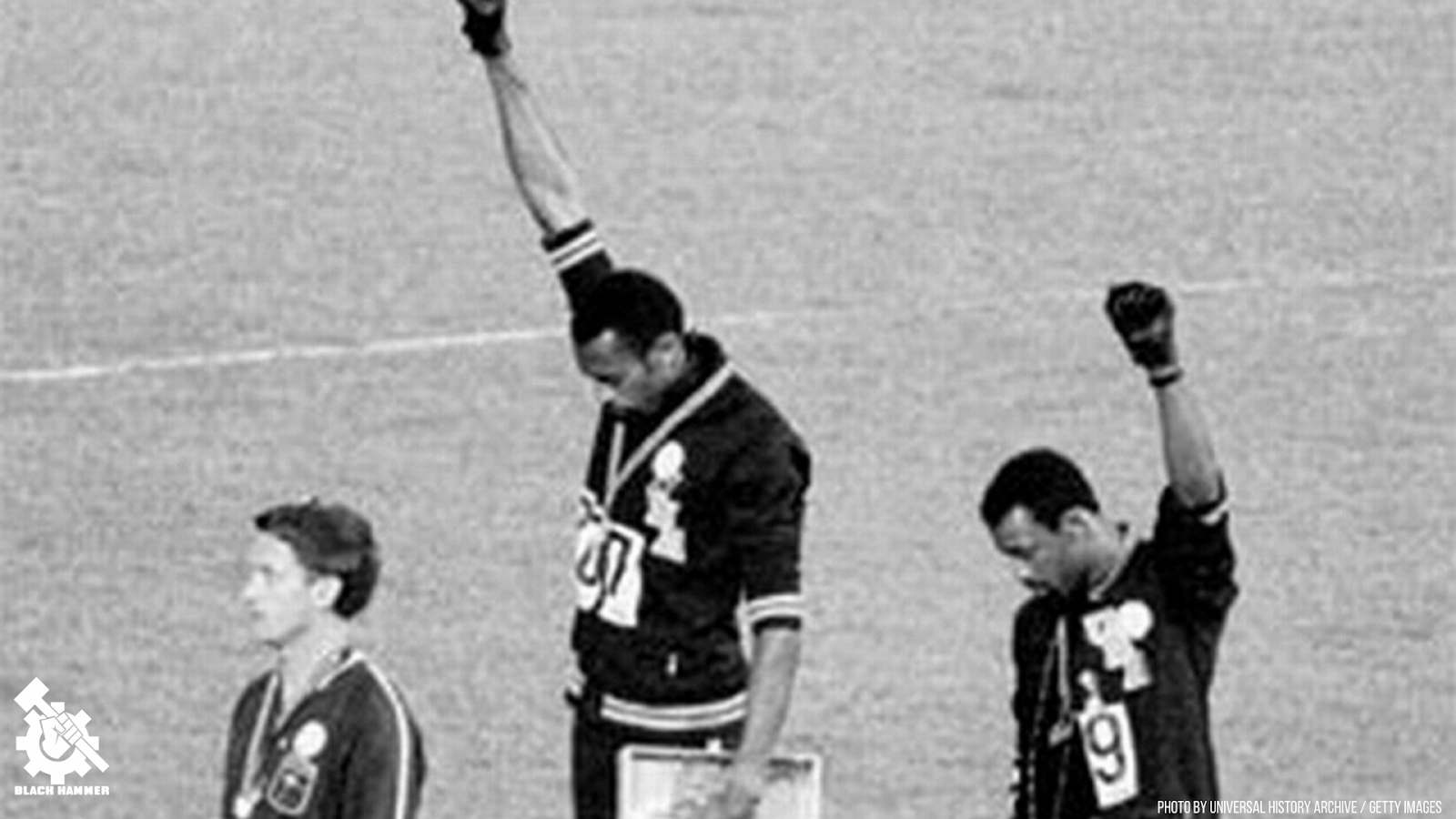 1968 Olympics: Tommie Smith (centre) and John Carlos (right) with fists raised on the podium in Mexico City