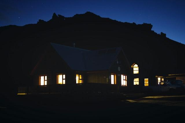 a house in the dark that needs exterior lighting