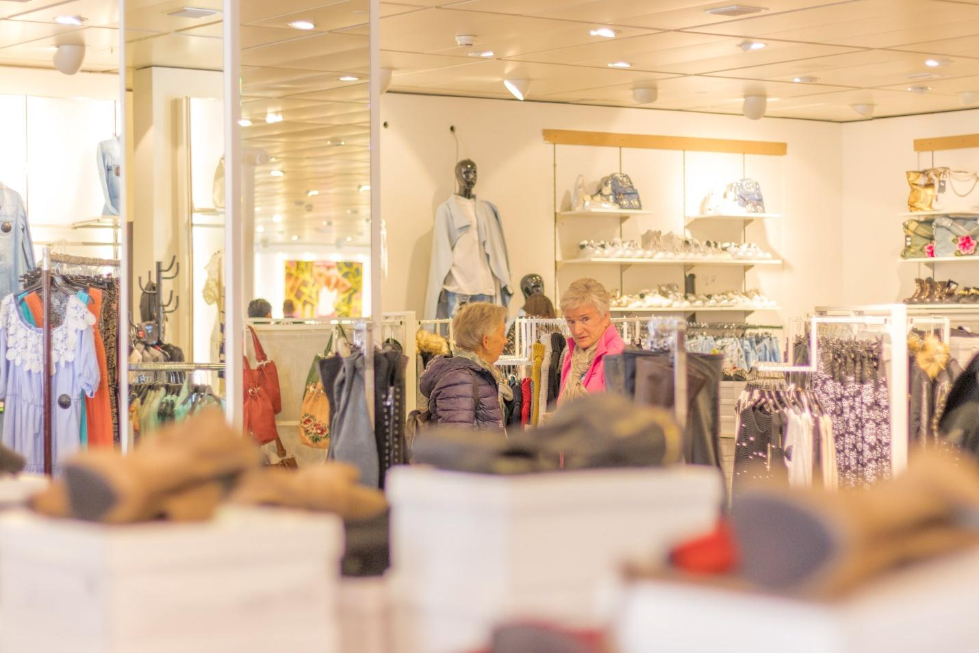 Two elderly women in a clothes shop