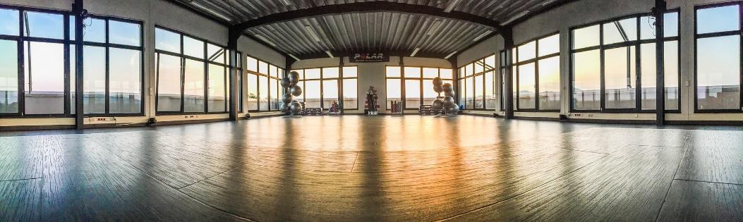 Using natural light is one of the tips for lighting fitness studios and gyms.