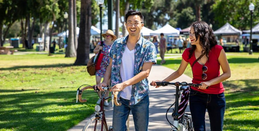 Couple with bikes visit neighborhood market