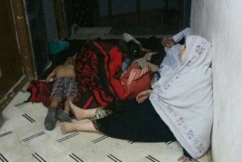 People rest after Aleppo attack