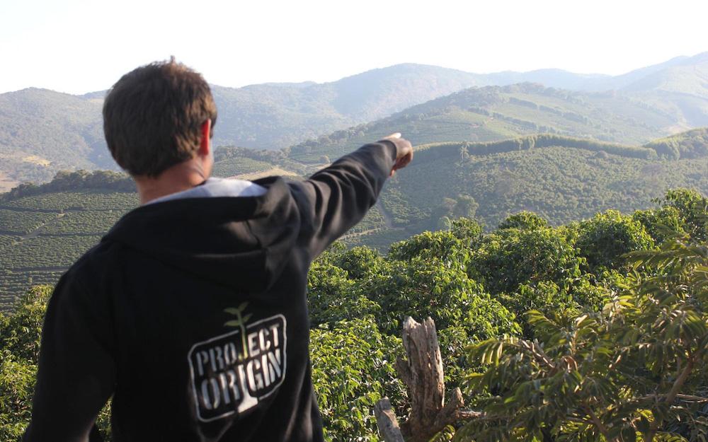sasa pointing at coffee plantations
