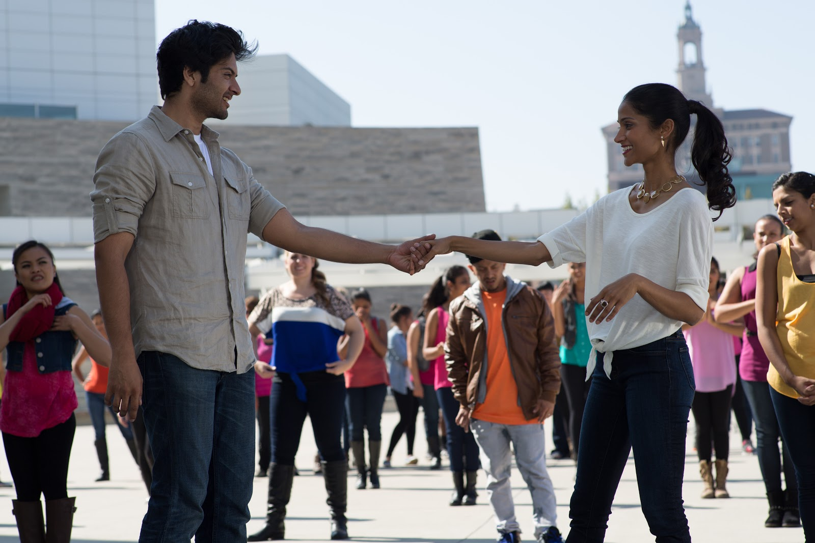 Ali Fazal and Melanie Kannokada outside San Jose City Hall in 'For Here or To Go?' directed by Rucha Humnabadkar. (Credit: Sean Graham)