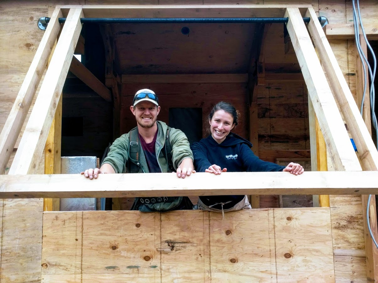 Timber Frame Tiny House on Wheels, Clara and Edwin Testing out the frame for their window