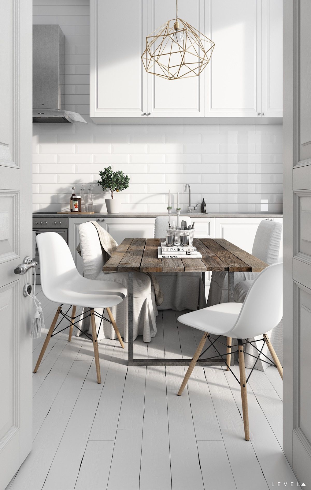 small white scandinavian kitchen with reclaimed wood table, white kitchen cabinets, white subway tile backsplash, white painted wood floors and stainless steel appliances